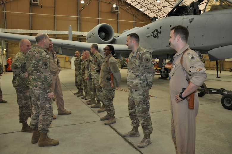 Gen. Mike Holmes, commander of Air Combat Command, and Chief Master Sgt. Frank H. Batten III, ACC command chief master sergeant, meet Airmen from the 75th Expeditionary Fighter Squadron at Kandahar Airfield, Afghanistan, Feb. 13, 2019.