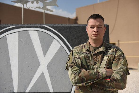 U.S. Army Sgt. 1st Class Timothy Hartranft, 9th Expeditionary Bomb Squadron ground liaison officer, stands in front of the 9th EBS T-Wall at Al Udeid Air Base, Qatar, Feb. 6, 2019. The GLO translates the ground units' intent into action in the air, also known as green to blue. All GLOs within the U.S. Central Command area of responsibility are supplied by the 4th Battlefield Coordination Detachment which is a unit under U.S. Army Central. (U.S. Air Force photo by Senior Airman Travis Beihl)