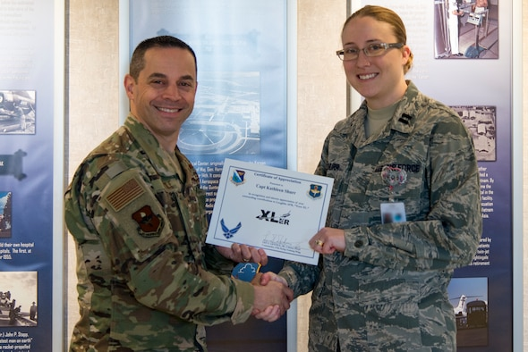 "Capt. Kathleen Shurr, 47th Medical Operations Squadron family health physician, was chosen by wing leadership to be the ""XLer"" of the week, for the week of Feb. 11, 2019, at Laughlin Air Force Base, Texas. The ""XLer"" award, presented by Col. Lee Gentile, 47th Flying Training Wing commander, is given to those who consistently make outstanding contributions to their unit and the Laughlin mission. (U.S. Air Force photo by Senior Airman Daniel Hambor)"
