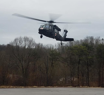 A West Virginia Army National Guard HH-60 Black Hawk assigned to Company C, 2-104th General Support Aviation Battalion (GASB), prepares to land in the parking lot of Ritchie County High School in Ellenboro, W.Va., following an aerial rescue mission of a stranded motorist Feb. 20, 2019.