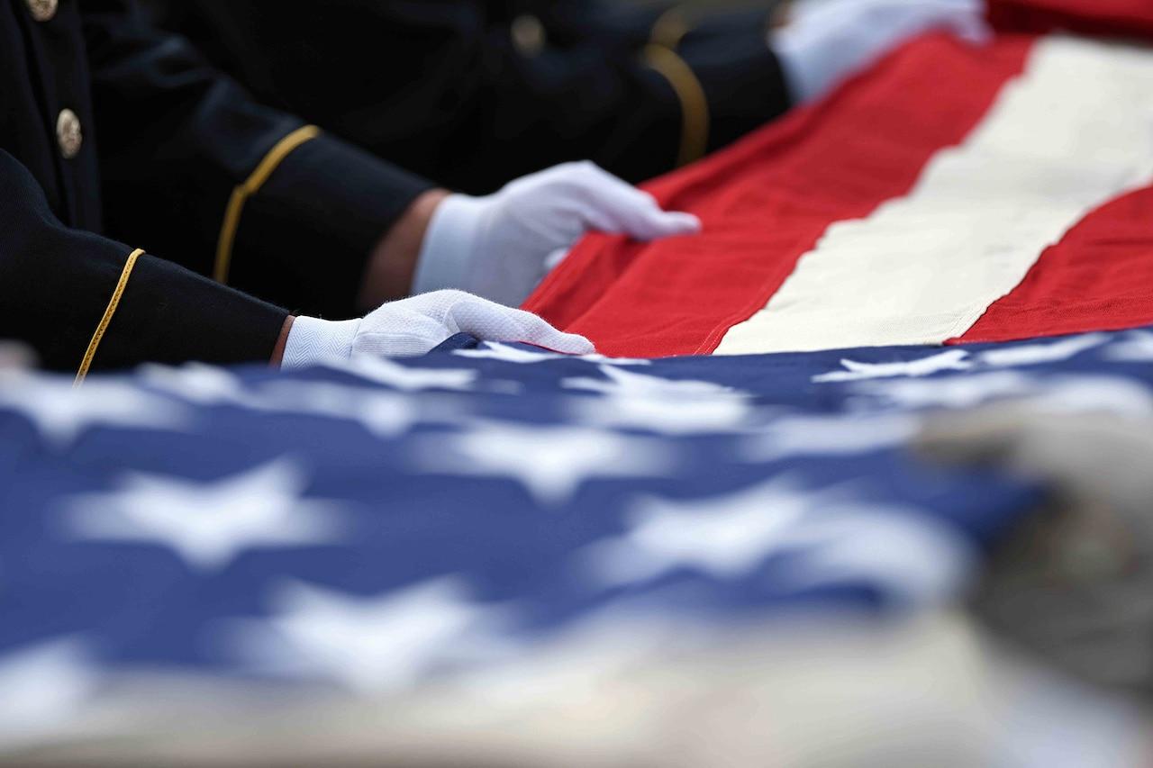 National Guardsmen complete a six-man flag fold.