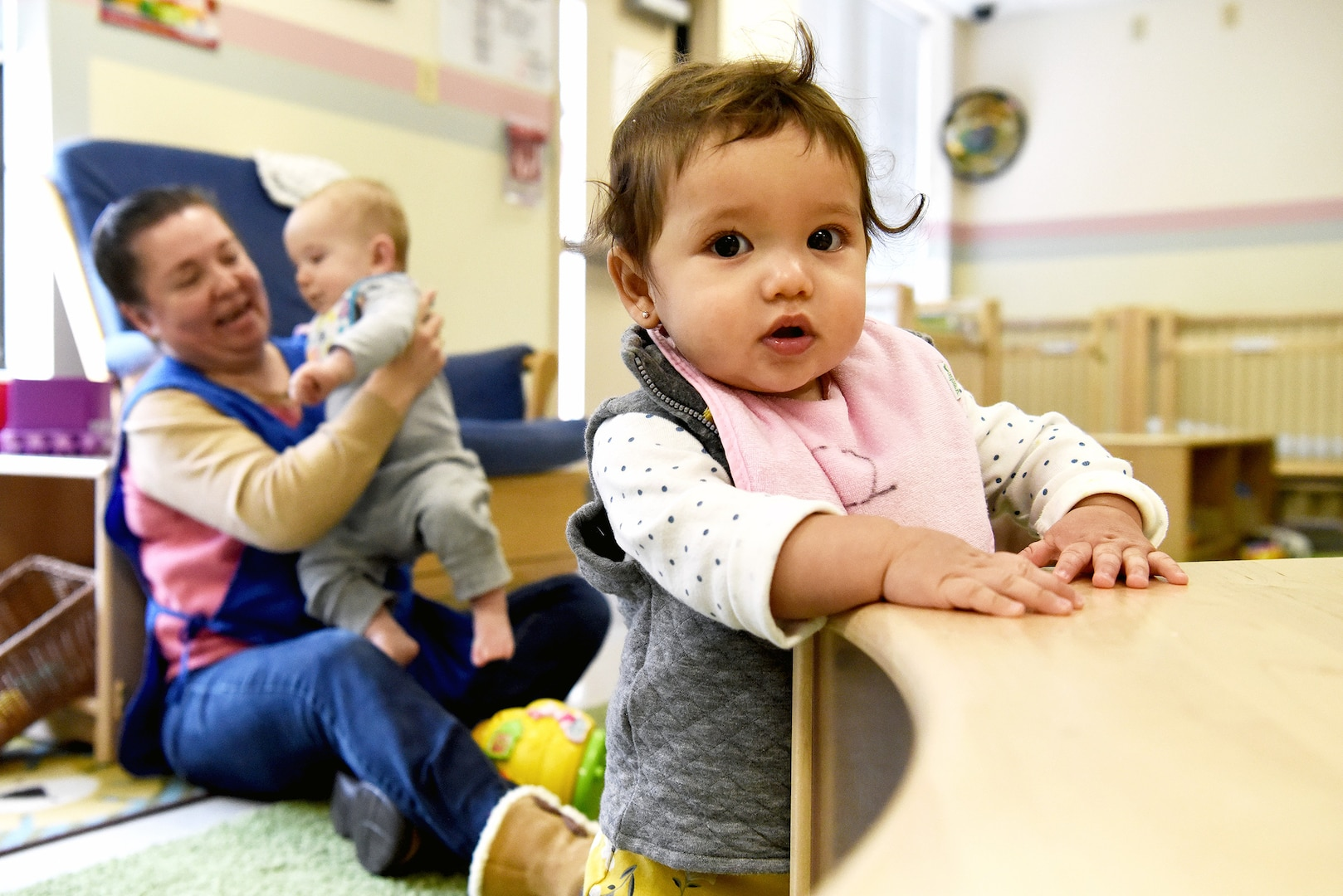 Roxanna Ramos cares for babies at the Defense Logistics Agency's Fort Belvoir, Virginia, Child Development Center, one of five centers at DLA major subordinate commands.