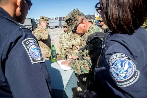 Marine Corps Brig. Gen. S.D. Slenka, commanding general of the 1st Marine Logistics Group, takes notes on the status of the border operation in Nogales, Arizona. DLA and Rapid Deployment Team Blue supported the effort by providing supplies to U.S. Northern Command.