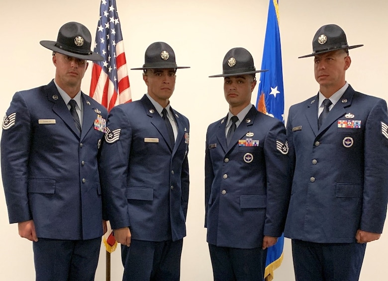 New 433rd Training Squadron Military Training Instructors Tech. Sgt. Jeremy Dawley, Tech. Sgt. Sammuel Alanis, Staff Sgt. Neftali Gomez-Diaz, and Tech. Sgt. Marc Chenail earned the right to wear the MTI hat, graduating from MTI school at Joint Base San Antonio-Lackland, Texas, earlier this month. Alanis also took home two of the top school awards: Commandants Award and Excellence in Instruction Award. (U.S. Air Force photo by Lt. Col. Christopher Victoria)