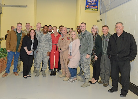 Actress Brie Larson (in red) poses for a photo with the 412th Test Wing Annual Award winners Feb. 20 in Bldg. 1600. (U.S. Air Force photo by Kenji Thuloweit)