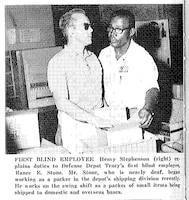 Henry Stephenson (right) explains duties to Rance Stone, Defense Depot Tracy's first blind employee, who was also nearly deaf, as featured in the Dec. 26, 1969, issue of DSA News.