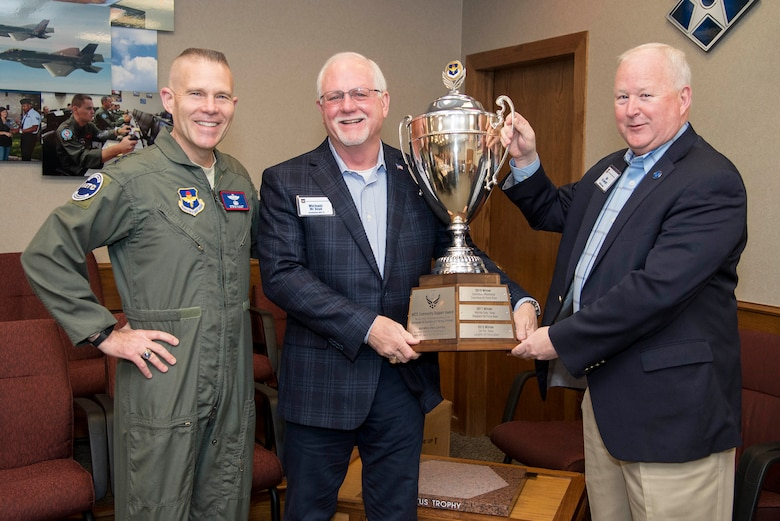 Lt. Gen. Steve Kwast (left), commander of Air Education and Training Command; Mr. Michael Boyd (center), Goodfellow Military Advisory Group member; and Dr. Joe Leverett, Altus Trophy committee chairman, hold up the Altus Trophy during the AETC Civic Leader's meeting Feb. 21, 2019, at Joint Base San Antonio-Randolph, Texas. The city of San Angelo (Texas) was awarded the trophy for 2019 for its outstanding community support to Goodfellow Air Force Base, Texas.