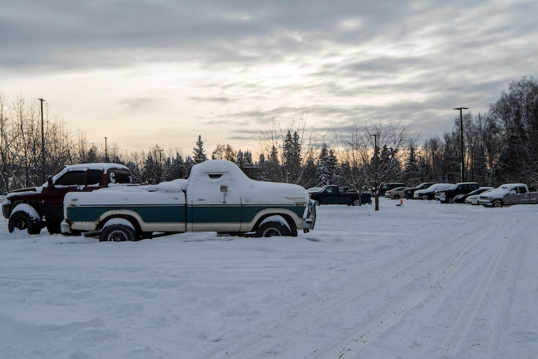Abandoned vehicles sit in the dormitory parking lots at Joint Base Elmendorf-Richardson, Alaska, Feb. 7, 2019. Some of these vehicles have created hazardous conditions by obstructing the path for snow-plowing vehicles.