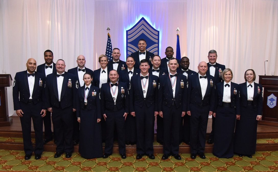 Recently inducted and current Keesler chief master sergeants pose for a photo during the Chief Induction Ceremony inside the Bay Breeze Event Center at Keesler Air Force Base, Mississippi, Feb. 15, 2019. Five Keesler Airmen earned their chief master sergeant stripe during the 2019 promotion release. Air Force officials selected 479 senior master sergeants for promotion to chief master sergeant out of 2,241 eligible for a selection rate of 21.37 percent. Chief master sergeants make up one percent of the Air Force enlisted force. (U.S. Air Force photo by Kemberly Groue)
