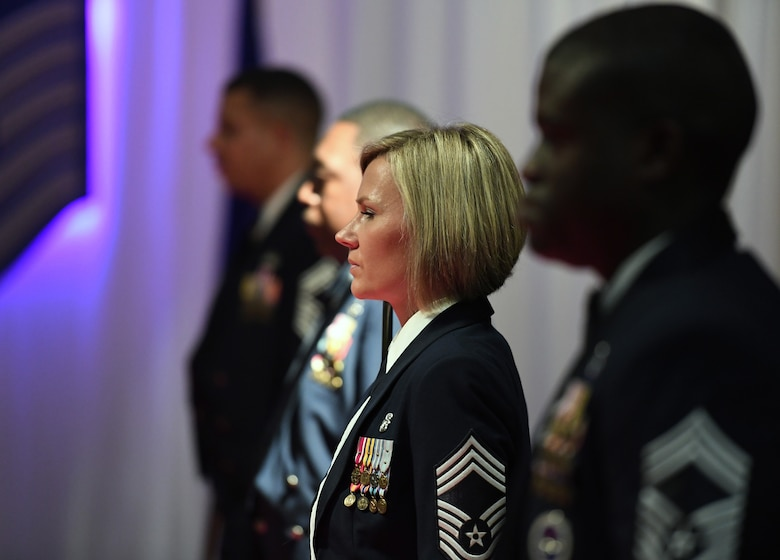 U.S. Air Force Chief Master Sgt. Jacey McDuffie, 81st Medical Support Squadron superintendent, and other Saber Sword Team members take their positions as they prepare to form a walk way with their saber swords for the honorees to walk through as they are introduced during the Chief Induction Ceremony inside the Bay Breeze Event Center at Keesler Air Force Base, Mississippi, Feb. 15, 2019. Five Keesler Airmen earned their chief master sergeant stripe during the 2019 promotion release. Air Force officials selected 479 senior master sergeants for promotion to chief master sergeant out of 2,241 eligible for a selection rate of 21.37 percent. Chief master sergeants make up one percent of the Air Force enlisted force. (U.S. Air Force photo by Kemberly Groue)