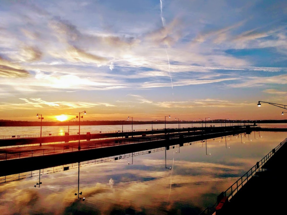 The sunrise at Smithland Locks and Dam in Brookport, Illinois, reflects off the high water in the lock chambers.