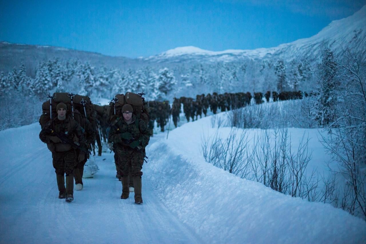 Marines marching through snow