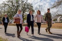 The Honorable Mrs. Phyllis L. Bayer, center, assistant secretary of the Navy for energy, installations and the environment, and Brig. Gen. Benjamin T. Watson, right, commanding general, Marine Corps Installations East-Marine Corps Base Camp Lejeune tour privatized military housing with spouses during a visit to Marine Corps Base Camp Lejeune, North Carolina, Feb. 15, 2019. Bayer visited MCB Camp Lejeune residential communities to assess on going restoration efforts on the installation. (U.S. Marine Corps photo by Lance Cpl. Isaiah Gomez)