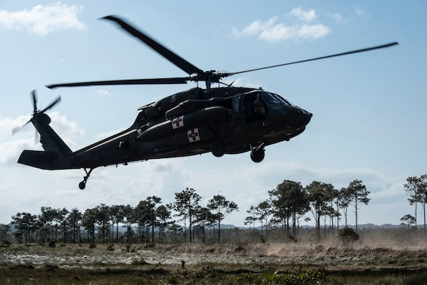 An HH-60 MEDEVAC returns from aerial gunnery training over a range in Belize, Feb. 12, 2019.
