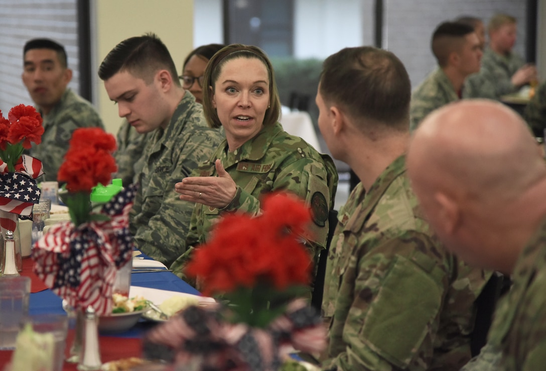 U.S. Air Force Chief Master Sgt. Juliet Gudgel, Air Education and Training Command command chief, speaks with Airmen about their Air Force experience at a lunch inside the Live Oak Dining Facility during a base immersion tour at Keesler Air Force Base, Mississippi, Feb. 15, 2019. Throughout the three-day tour Gudgel received 2nd Air Force and 81st Training Wing mission briefings, ate breakfast with Airmen in training, received an 81st Security Forces Squadron military working dog demonstration and served as the guest speaker at the Chief Master Sergeant Induction Ceremony. (U.S. Air Force photo by Kemberly Groue)