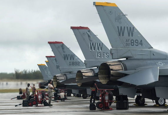 U.S. Air Force Airmen from the 13th Fighter Squadron, Misawa Air Base, Japan, stands by for F-16 Fighting Falcon's to taxi onto a runway at Andersen Air Force Base, Guam, during COPE North 19, Feb. 19, 2019.