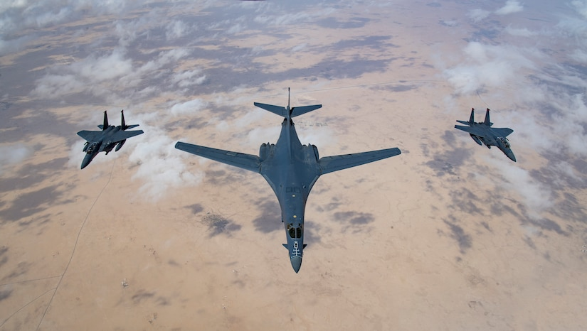 A U.S. Air Force B-1B Lancer bomber and F-15E Strike Eagles fly in formation during Joint Air Defense Exercise 19-01, Feb. 19, 2019. The aircraft participated in the flying portion of the combined defense exercise with regional partners to practice command and control tactics, techniques and procedures. JADEX is an opportunity to test and improve combined air and missile defense capabilities and ensure Joint Coalition partners are prepared to defend against external threats with a variety of capabilities and assets. (U.S. Air Force photo by Staff Sgt. Clayton Cupit)