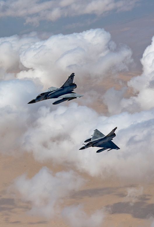 Two Qatari Mirage 2000s fly in formation during Joint Air Defense Exercise 19-01, Feb. 19, 2019. The aircraft participated with U.S. and regional partners to test objective-based command and control actions during the exercise. (U.S. Air Force photo by Staff Sgt. Clayton Cupit)