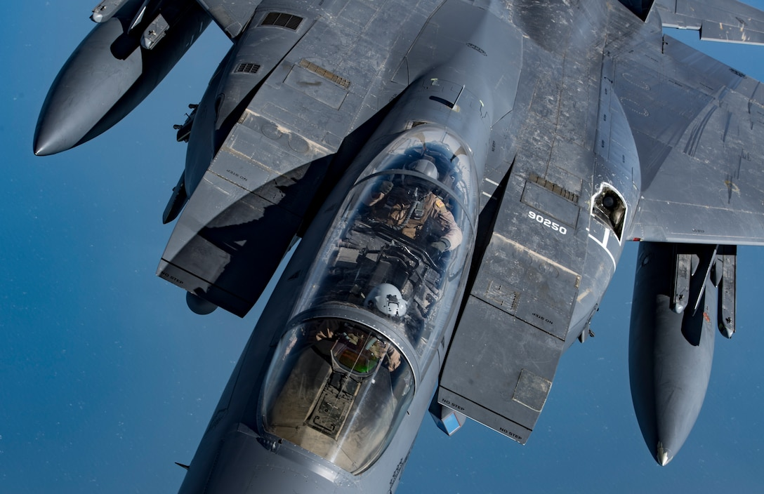 "A weapon systems officer gives a ""thumbs-up"" in a U.S. Air Force F-15E Strike Eagle after aerial refueling provided by a KC-135 Stratotanker during Joint Air Defense Exercise 19-01, Feb. 19, 2019. The aircraft participated with regional partners to test objective-based command and control actions during the exercise. (U.S. Air Force photo by Staff Sgt. Clayton Cupit)"