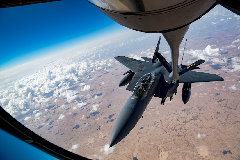 A U.S. Air Force F-15E Strike Eagle maneuvers into position to receive fueled from a KC-135 Stratotanker as a part of Joint Air Defense Exercise 19-01, Feb. 19, 2019. The aircraft participated with regional partners to test objective-based command and control actions during the exercise. (U.S. Air Force photo by Staff Sgt. Clayton Cupit)