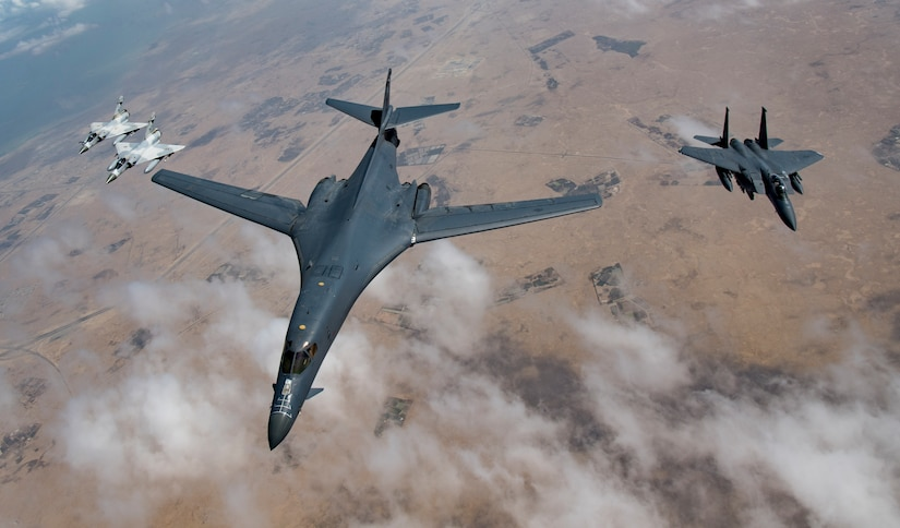 Qatari Mirage 2000s, a U.S. Air Force B-1B Lancer bomber and an F-15E Strike Eagle fly in formation during Joint Air Defense Exercise 19-01, Feb. 19, 2019. The aircraft and crews participated in the exercise together to test objective-based command and control during the exercise. (U.S. Air Force photo by Staff Sgt. Clayton Cupit)