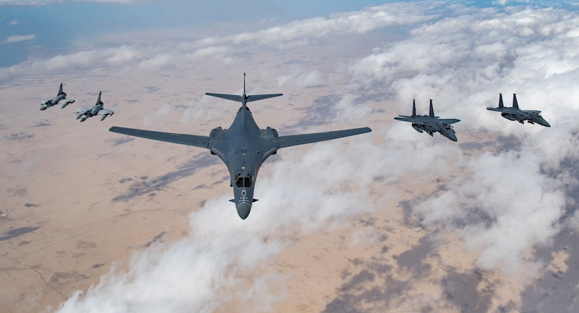 Qatari Mirage 2000s, a U.S. Air Force B-1B Lancer bomber and F-15E Strike Eagles fly in formation during Joint Air Defense Exercise 19-01, Feb. 19, 2019. JADEX provides an opportunity to strengthen military-to-military relationships with the Qatari Air Force while conducting combined air operations with partners. (U.S. Air Force photo by Staff Sgt. Clayton Cupit)