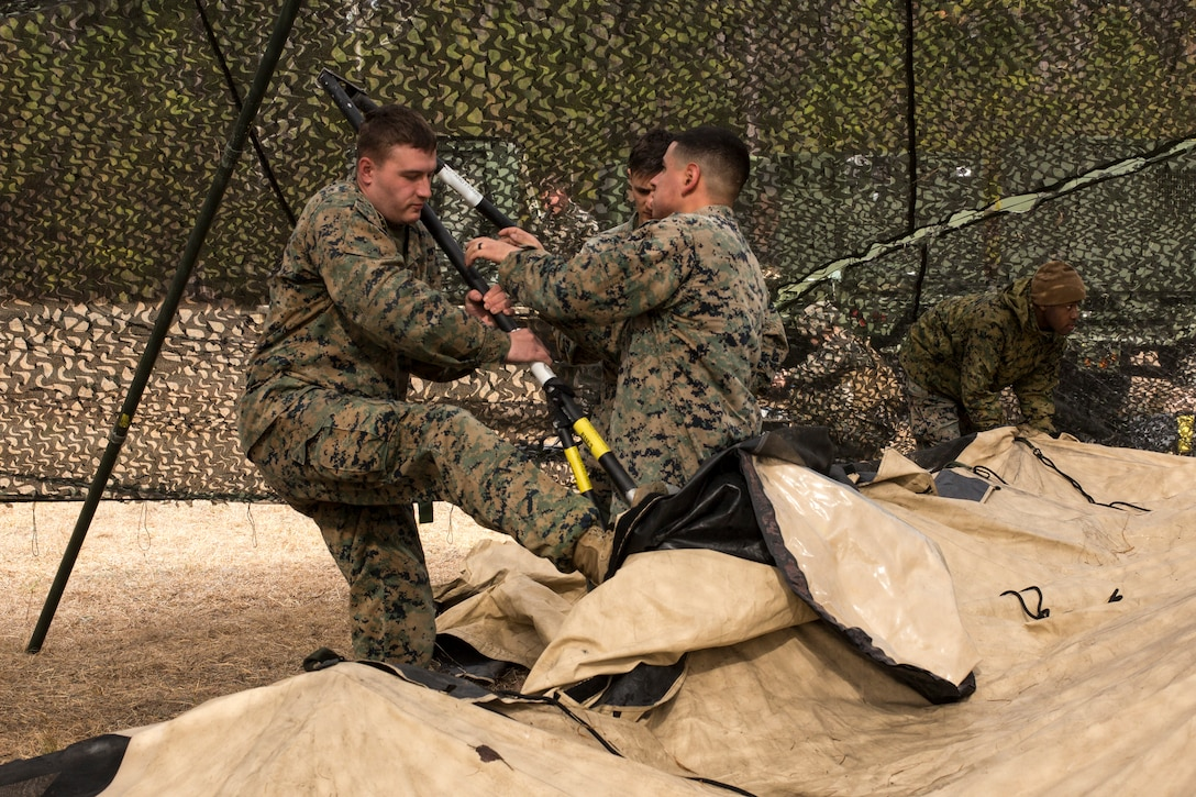 U.S. Marines with Headquarters Battalion, 2nd Marine Division, set up a combat operations center during Tent Exercise 1-19 on Camp Lejeune, N.C., Feb. 4-15, 2019. The two-week-long exercise tested 2nd Marine Division's ability to rapidly break down and re-establish a combat operations center in a field environment, which is essential to the effectiveness and survivability of the command element. (U.S. Marine Corps photo by Cpl. Liah A. Smuin)