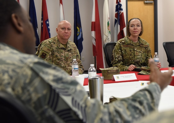 U.S. Air Force Chief Master Sgt. Terry Harris, 338th Training Squadron superintendent, briefs the 338th TRS mission and capabilities during the 81st Training Group mission brief to Chief Master Sgt. Juliet Gudgel, Air Education and Training Command command chief, as Chief Master Sgt. David Pizzuto, 81st Training Wing command chief, listens on inside the Levitow Training Support Facility during Gudgel's base immersion tour at Keesler Air Force Base, Mississippi, Feb. 15, 2019. The 338th TRS training focuses on radio frequency transmission, airfield systems, ground radar, and cyber transport. Throughout the three-day tour, Gudgel received 2nd Air Force and 81st Training Wing mission briefings, ate breakfast with Airmen in training, received an 81st Security Forces Squadron military working dog demonstration and served as the guest speaker for the Chief Master Sergeant Induction Ceremony. Gudgel toured the base to immerse herself in the training missions carried out in support of the command's effort to produce more agile and capable Airmen for the 21st Century. (U.S. Air Force photo by Kemberly Groue)