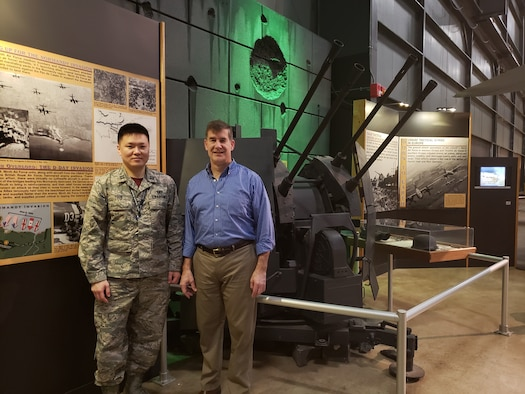 Capt. Yongjun Yoon, an RF sensing engineer from the RF Technology Branch at AFRL's Sensors Directorate, and David Sobota, with the Sensors Effects and Analysis Branch, in front of a ZPU-4 Soviet-built anti-aircraft gun at the National Museum of the United States Air Force.