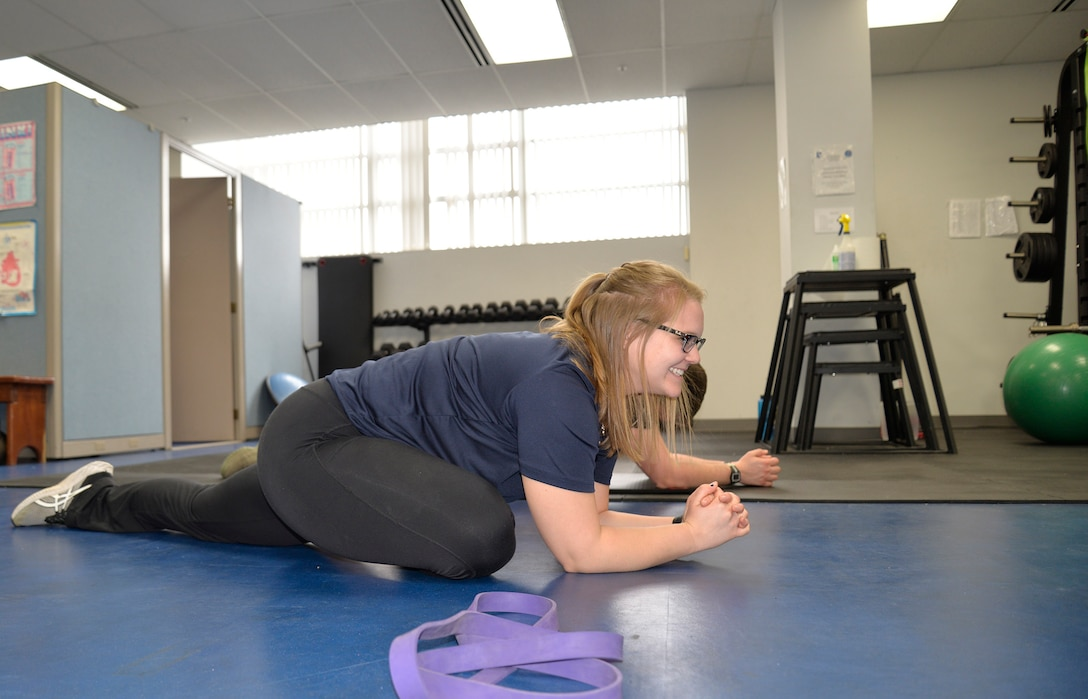 Hannah Kohne, a contractor at the 711th Human Performance Wing, takes Staff Sgt. Alan Gagnon through a stretching routine as a part of the Function Bridge Fitness Study at Wright Patterson Air Force Base, Feb. 14th, 2019.