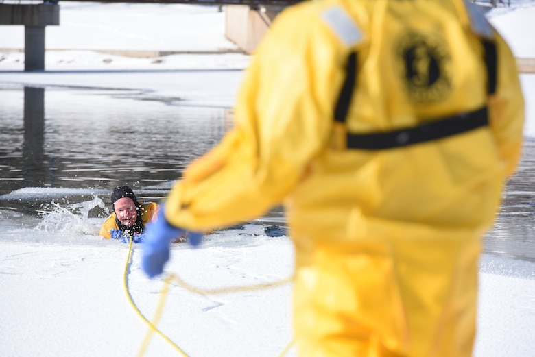Hunter Harlan, a Rapid City Fire Department ice rescue instructor, demonstrates how a person can be saved should they become the victim of an ice water accident at Canyon Lake in Rapid City, S.D., Feb. 12, 2019. The instructors stressedthe importance of not only keeping calm during an ice water emergency but also making sure the rescuers protect themselves. (U.S. Air Force photo by Senior Airman Michella Stowers)