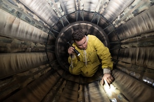 Staff Sgt. Adam Bowen, 55th Expeditionary Fighter Squadron phase floor chief, inspects an F-16C Fighting Falcon's engine