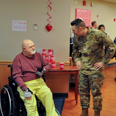 Col. Thomas Sherman, 88th ABW commander, speaks with a veteran at the Dayton Veterans Affairs Medical Center, Dayton, Ohio, Feb. 14, 2019.