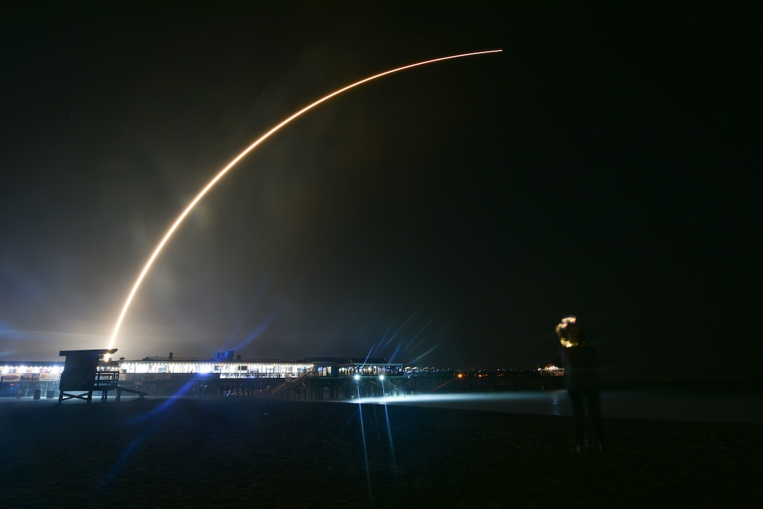 People watch SpaceX's Falcon 9 rocket PSN VI launch from Cape Canaveral Air Force Station, Fla., Feb. 21, 2019 at Cocoa Beach, Fla. The satellite will provide communication and internet services for Indonesia and South East Asia. (U.S. Air Force photo by Airman 1st Class Dalton Williams)