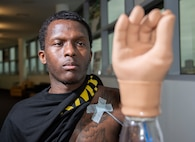 U.S. Army Staff Sgt. Kayshawn Porterfield practices using a myoelectric prosthesis at Brooke Army Medical Center's Center for the Intrepid, Joint Base San Antonio-Fort Sam Houston Feb. 21. A myoelectric-controlled prosthesis is an externally powered artificial limb that the user controls with electrical signals generated naturally with his own muscles.