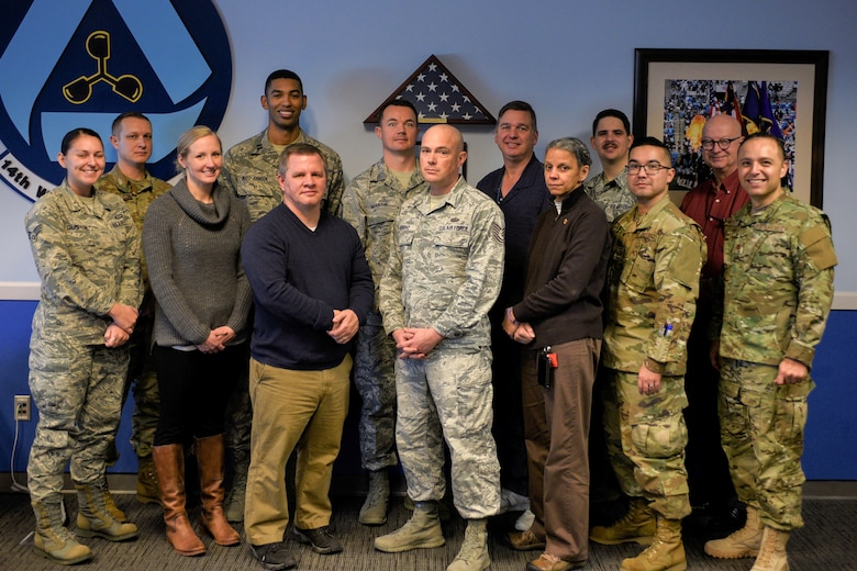 Members of the 14th Weather Squadron Climate Go-Kit development team pose for a group photo at their Asheville, North Carolina, office Jan. 31, 2019. By utilizing in-house resources, the development team was able to build the go-kit system in approximately six months, saving approximately $128,000 versus outsourcing the development. (U.S. Air Force photo by Staff Sgt. Charles Buckler)