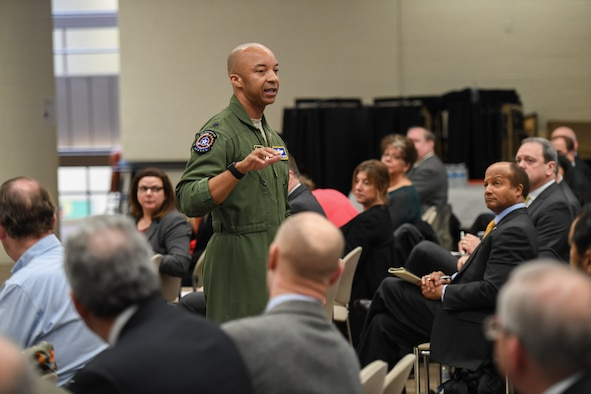 Lt. Col. Randy Gordon of the Air Force's AFWERX program addresses more than 100 industry representatives during the Feb. 20 Multi-Domain Command and Control Industry Day, held at the Minuteman Educational Center in Lexington, Mass. Gordon compared AFWERX and MDC2 efforts with the Doolittle Raiders, who innovated and iterated their way to launch bombers off aircraft carriers to strike at the industrial heart of Japan during World War II. (U.S. Air Force photo by Jerry Saslav)