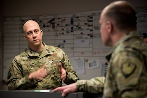 Col. Josh Olson, 22 Air Refueling Wing commander, speaks to U.S. Army Gen. Stephen R. Lyons, U.S. Transportation Command commander, Feb. 21, 2019, at McConnell Air Force Base, Kan. During the visit, Lyons was briefed on McConnell's operations, readiness and what the installation provides to the USTRANSCOM. (U.S. Air Force photo by Airman 1st Class Alan Ricker)