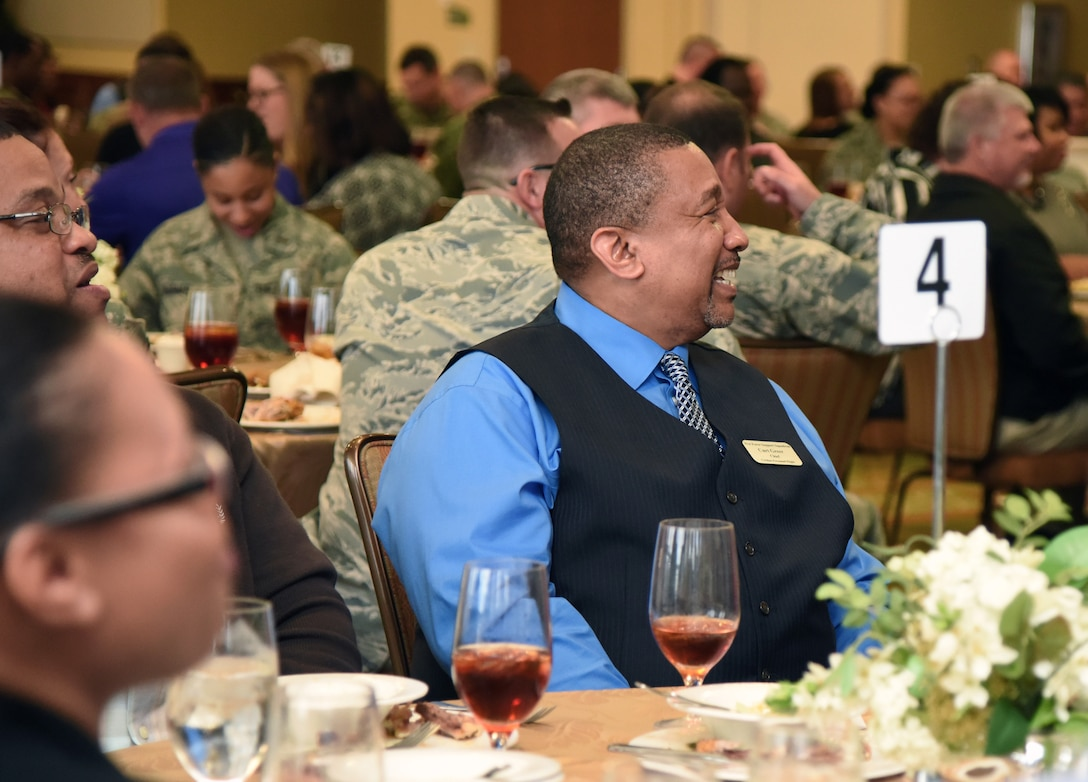 "Curtis Greer, 81st Force Support Squadron civilian personnel flight chief, laughs as U.S. Air Force Retired Maj. Gen. Mark Brown delivers his remarks as the guest speaker during the Black History Month Luncheon inside the Bay Breeze Event Center at Keesler Air Force Base, Mississippi, Feb. 20, 2019. Brown served as the 2nd Air Force commander at Keesler from July 2014 through August 2016. The theme of Black History Month this year is ""Black Migrations."" The theme emphasizes the movement of people of African descent to new destinations and subsequently to new social realities in the U.S. Keesler hosted several events throughout the month to include a 5K run, luncheon, movies and will conclude with a close-out celebration Feb. 28. The events are meant to help Keesler personnel to remember, educate and celebrate black history. (U.S. Air Force photo by Kemberly Groue)"
