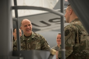 U.S. Army Gen. Stephen R. Lyons, U.S. Transportation Command commander, speaks with Tech. Sgt. Michael Walsh, 22nd Maintenance Squadron aerospace ground equipment section lead, Feb. 21, 2019, at McConnell Air Force Base, Kan. Walsh demonstrated the size differences between KC-46A Pegasus and KC-135 Stratotanker AGE equipment during Lyons' visit. (U.S. Air Force photo by Airman 1st Class Alan Ricker)