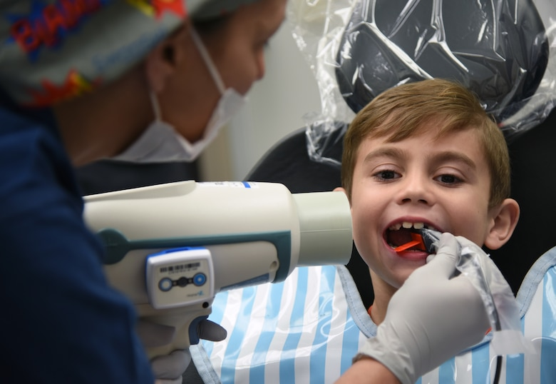 Regina Yarbrough, 81st Dental Squadron dental technician, conducts an X-ray exam on Raylan Wanhala, son of U.S. Air Force Tech. Sgt. Daniel Wanhala, 81st Security Forces Squadron flight chief, during the 9th Annual Give Kids a Smile Day at the dental clinic inside the Keesler Medical Center at Keesler Air Force Base, Mississippi, Feb. 15, 2019. The event was held in recognition of National Children's Dental Health Month and included free dental exams, radiographs and cleanings for children age two and older for more than 60 children. The clinic provided approximately $16,000 in care during the free screening. (U.S. Air Force photo by Kemberly Groue)