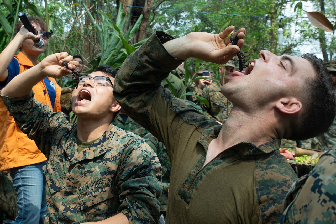 Two men eat scorpions