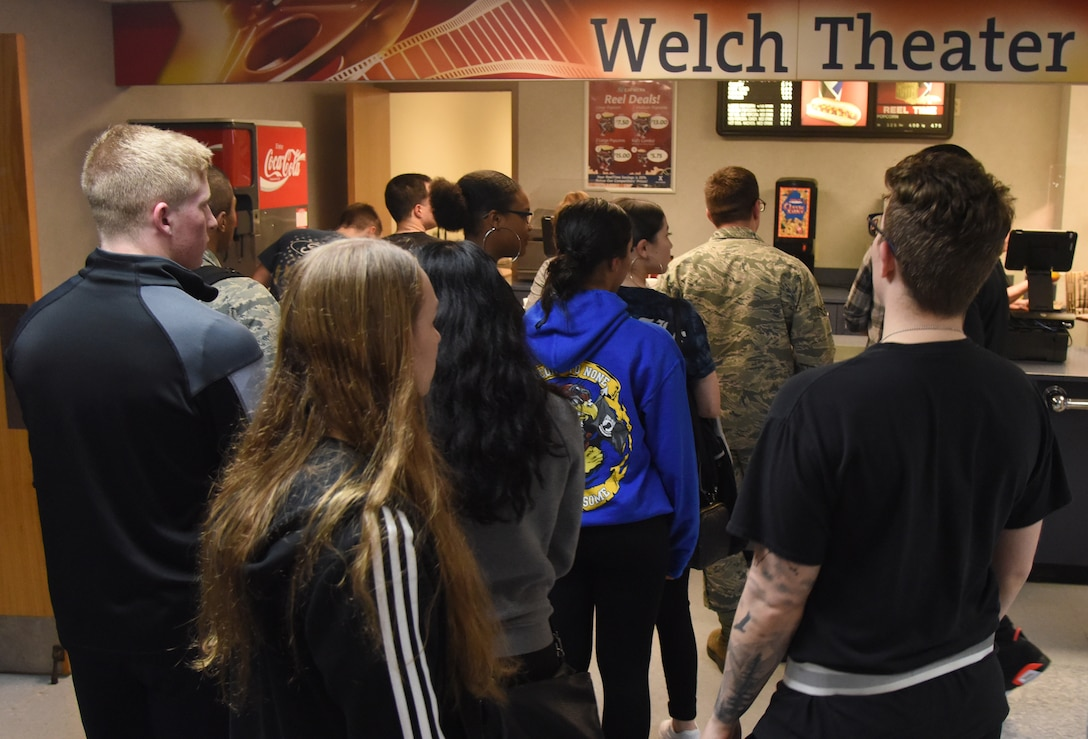 Airmen from the 81st Training Group stand in line for refreshments to watch the movie, 42, inside the Welch Theater at Keesler Air Force Base, Mississippi, Feb. 21, 2019. The movie, a story of Jackie Robinson's rise to fame in Major League Baseball, was shown in celebration for Black History Month. Keesler hosted several events throughout the month to include a 5K run, luncheon, movies and will conclude with a close-out celebration Feb. 28. The events are meant to help Keesler personnel to remember, educate and celebrate black history. (U.S. Air Force photo by Kemberly Groue)