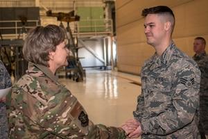 General coining Airman.