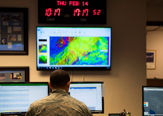 Senior Airman Christopher Smith, 56th Operations Support Squadron Weather Flight journeyman, reviews a forecast at Luke Air Force Base, Ariz., Feb. 14, 2019.