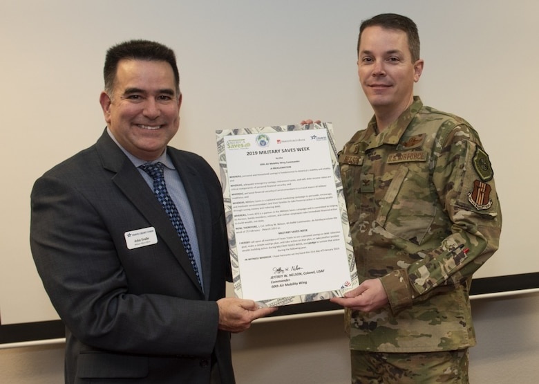 John Evalle, left,Travis Credit Union Military Affairs Officer and U.S. Air Force Col. Jeffrey Nelson, 60th Air Mobility Wing commander, pose with a proclamation designating Feb. 25 through March 1, 2019 Military Saves Week at the Airman and Family Readiness Center, Feb. 21, 2019, Travis Air Force Base, California. The Military Saves Week program encourages Airman to save for the future and to reduce debt. The event is a team effort between the A&FRC, Travis Credit Union and Armed Forces Bank. (U.S. Air Force Photo by Heide Couch)
