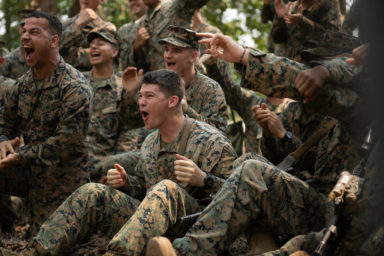 A group of Marines cheer during jungle training.
