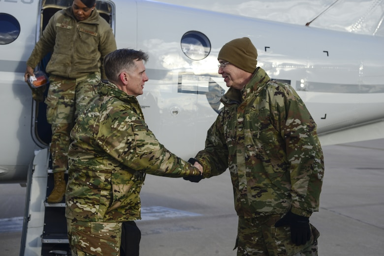 Col. Richard Gibbs (right), 377th Air Base Wing commander, greets Air Force Global Strike Command commander Gen. Timothy Ray upon arrival at Kirtland Air Force Base, N.M., Feb. 19, 2019. The general made a two-day visit to the base and Kirtland's 377th ABW, having meals with 377th ABW Airmen, receiving briefings and meeting with wing leadership and key spouses. (U.S. Air Force photo by Staff Sgt. Kimberly Nagle)