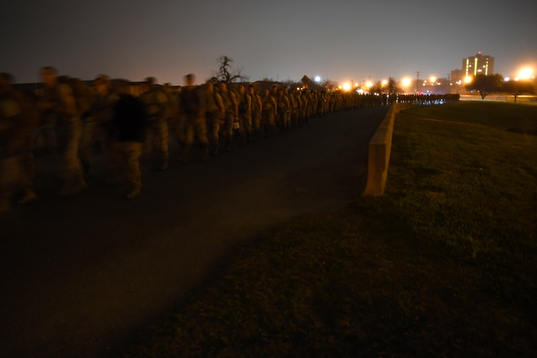 Special Tactics Airmen with the 24th Special Operations Wing lead hundreds of Airmen, trainees, and supporters during the initial five-mile starting leg of the Special Tactics Memorial March Feb. 22, 2019, at Lackland Air Force Base, Texas.