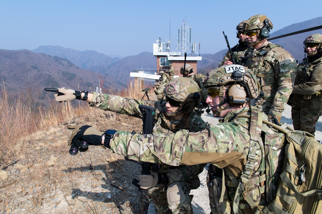 U.S. Air Force joint terminal attack controllers assigned to the 604th Air Support Operations Squadron and 607th Air Support Operations Group make an assessment prior to calling in an A-10 Thunderbolt II strafing run during close air support training at the Pilsung Range in Gangwan Province, Republic of Korea, Feb. 14, 2019.